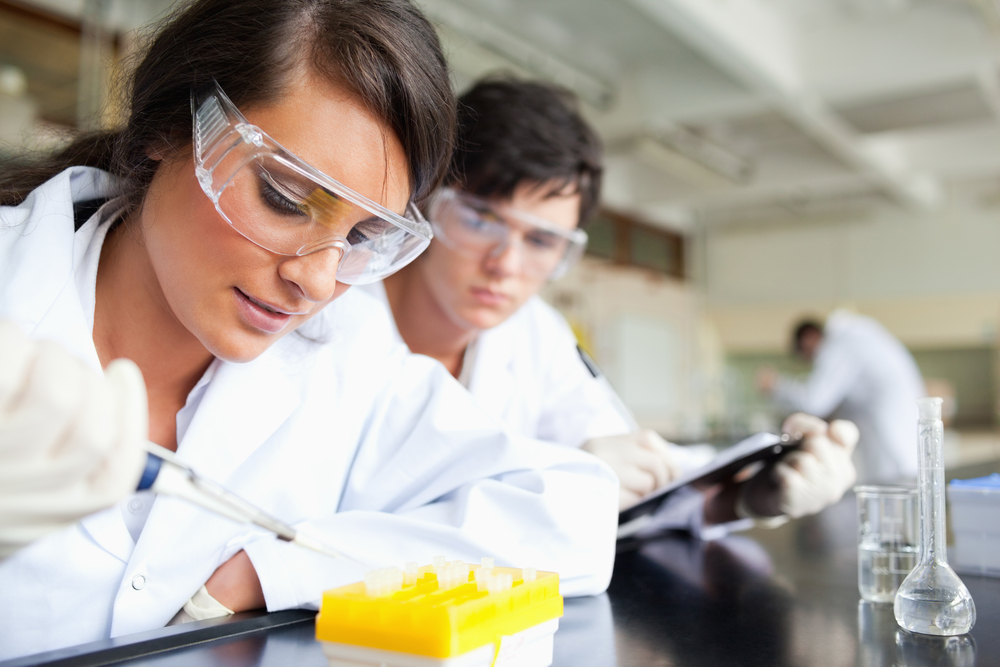 Two young scientists making an experiment in a laboratory-1